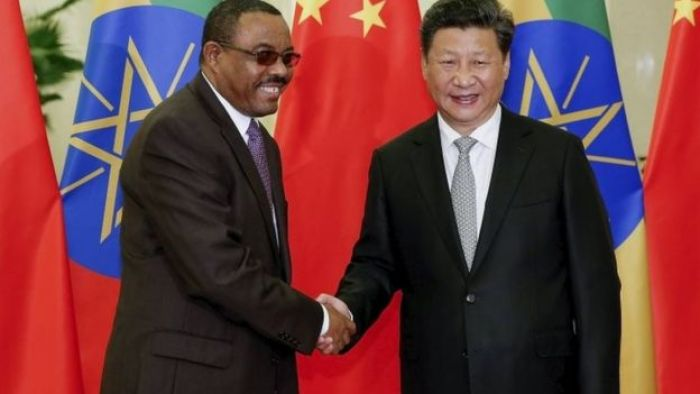 Chinese President Xi Jinping (R) shakes hands with Ethiopian Prime Minister Hailemariam Desalegn (L) at the Great Hall Of The People in Beijing, China 4 September 2015