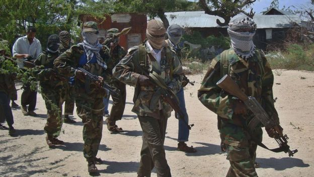 A file photo taken on 5 March 2012 al-Shabab recruits walking down a street in the Deniile district of the Somalian capital, Mogadishu