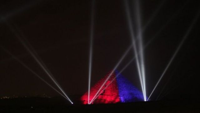 The Great Pyramids are illuminated for New Year's Eve in Giza, near Cairo