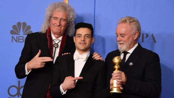 Rami Malek con Brian May y Roger Taylor de Queen