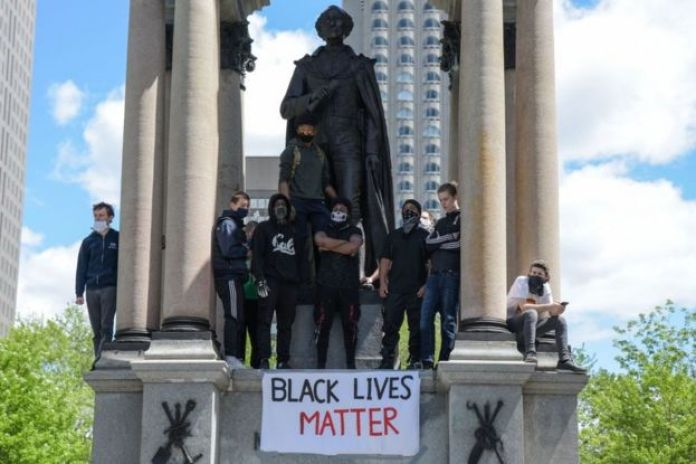 In June activists hung banners from the statue during anti-racism protests