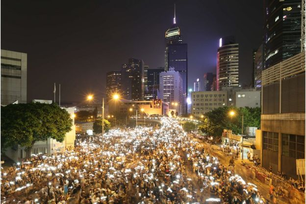 In this long exposure photo, Pro-democracy demonstrators holding up their smartphones during a protest near the Hong Kong government headquarters on 29 September 2014.