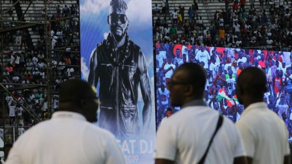 Fans attend a tribute ceremony