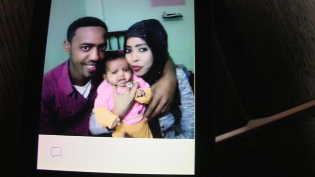 A photo of Muaz Ayimo with his wife and his daughter who died in the sinking