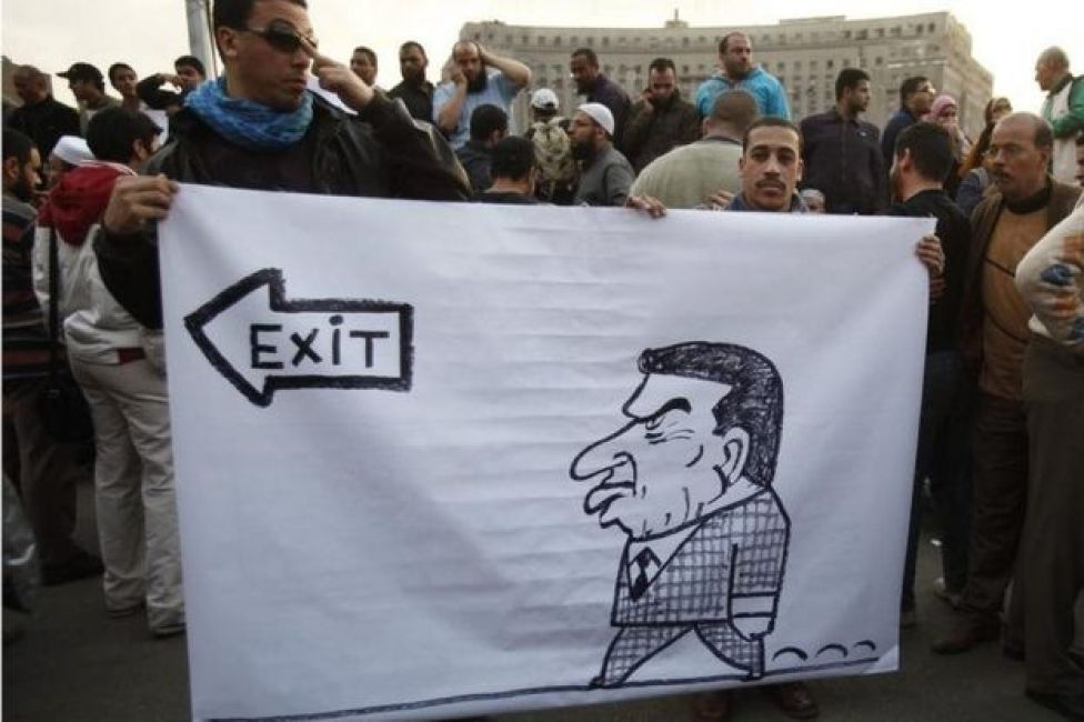 Protesters hold caricature of Egyptian President Hosni Mubarak in Cairo in 2011