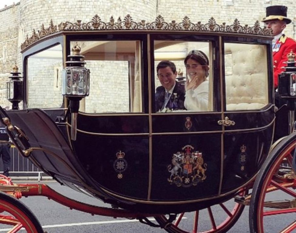 Princess Eugenie and Jack Brooksbank wave from their carriage