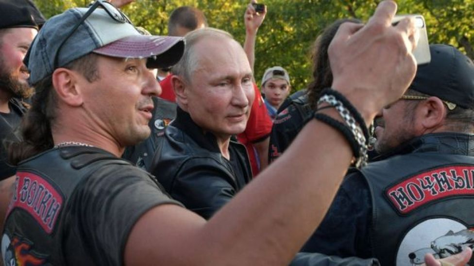 """Russia's President Vladimir Putin greets participants of a bike show organized by motorcycling club """"Night Wolves"""" in Sevastopol, Crimea on 10 August 2019"""