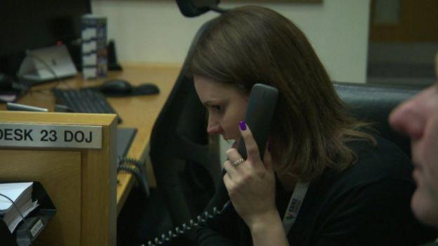 Karen McMillan answering telephone