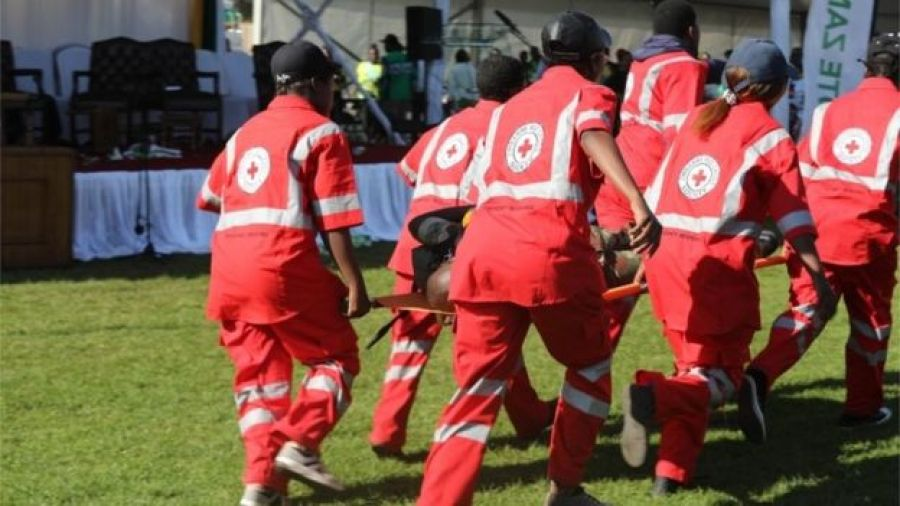 Members of the Zimbabwe Red Cross Society (ZRCS) carry an injured member of the Zimbabwe National Army (ZNA), who was reportedly injured after a bomb went off at a rally addressed by President Emmerson Mnangagwa, at White City Stadium in Bulawayo, Zimbabwe, 23 June 2018