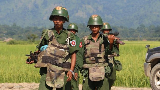 Myanmar soldiers patrol a village in Maungdaw located in Rakhine State, 21 October