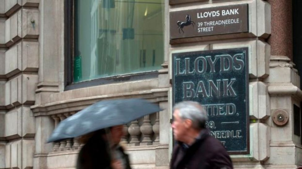People standing outside Lloyds Bank in the City of London