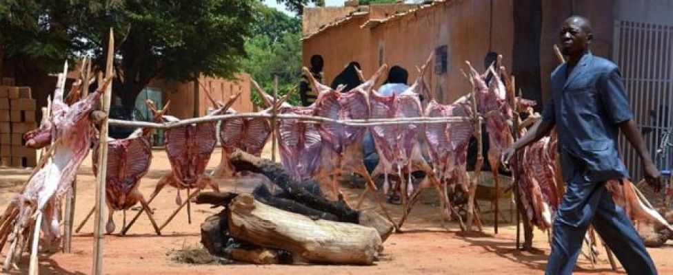 A man walks past sheep carcases staked around a log fire along a street in Niamey as Muslims celebrate Eid al-Adha on September 12, 2016. Muslims across the world celebrate the annual festival of Eid al-Adha, which marks the end of the Hajj pilgrimage to Mecca and commemorates prophet Abraham's readiness to sacrifice his son to show obedience to God.