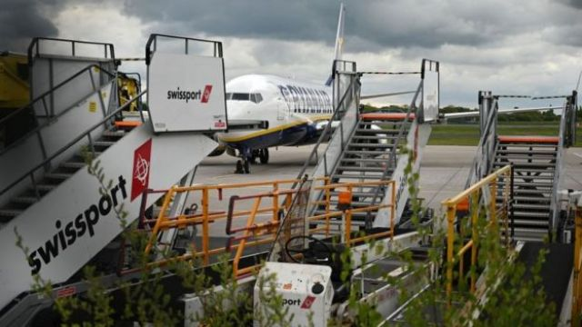 Swissport stairs and other ground equipment by a Ryanair jet at Manchester Airport in May
