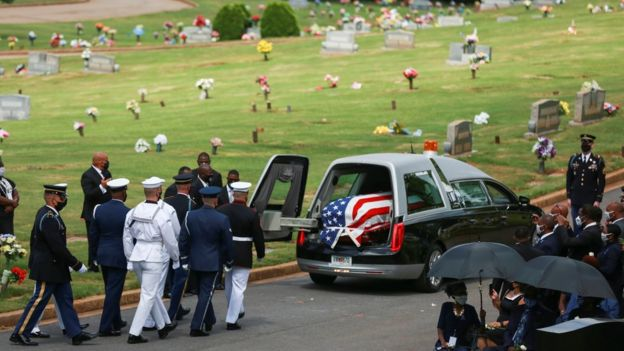 the hearse carrying Lewis's body