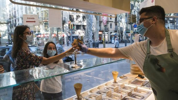 People visit a Rocambolesc ice cream store at La Rambla on July 27, 2020 in Barcelona, Spain. Spanish officials insisted it was still safe to travel to the country despite a recent rise in coronavirus