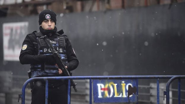 A Turkish police officer stands guard close to the site of an armed attack near the Reina night club on 1 January 2017