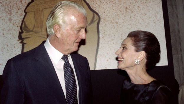 Hubert de Givenchy (L) and Audrey Hepburn talk together at the Galliera Museum in Paris in 1991