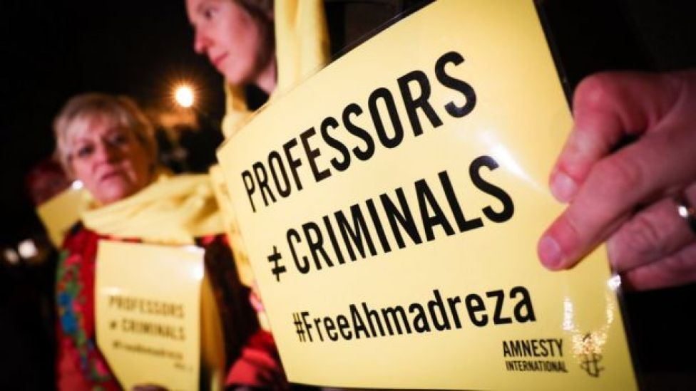People take part in a rally on 14 December 2017 at the Iranian embassy in Brussels, in support of Ahmadreza Djalali after Iran's Supreme Court upheld the death sentence handed to him, an Iranian-born Swedish resident and specialist in emergency medicine