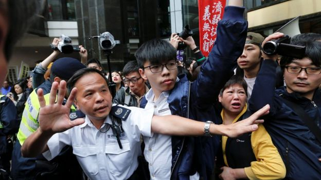 Pro-democracy activist Joshua Wong (centre) at protests on election day in Hong Kong