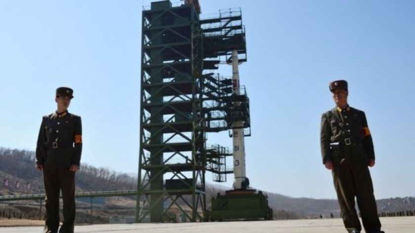 North Korean soldiers in front of the Unha-3 rocket at at the Sohae Satellite Launch Station in Tongchang-Ri (2012)