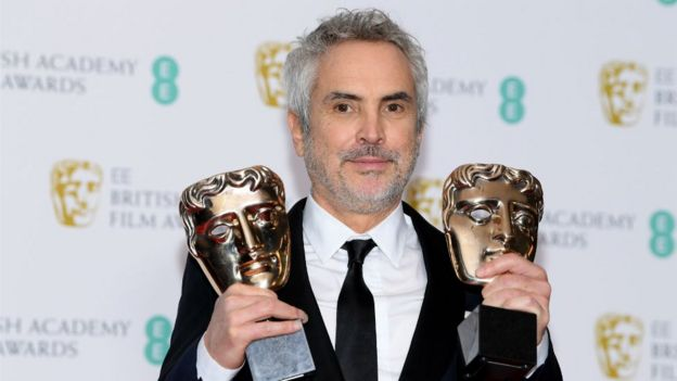 Alfonso Cuarón with his two Bafta awards