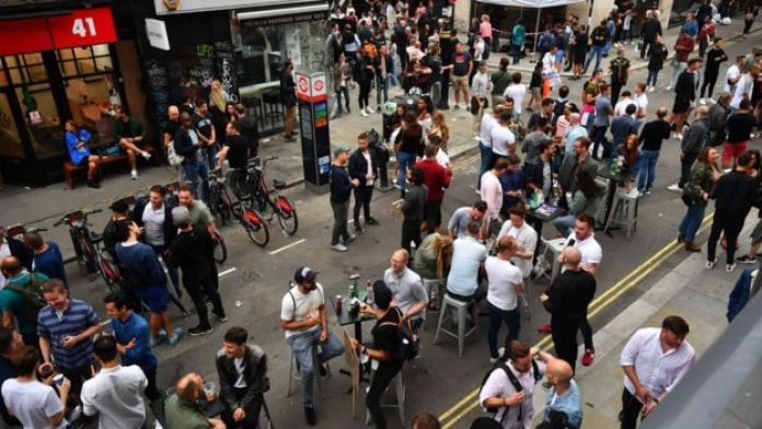 Drinkers gather in Soho