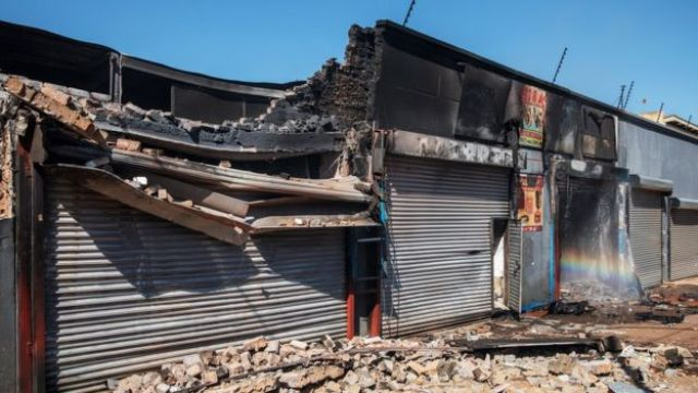 A partially destroyed shop is seen in Johannesburg's Malvern suburb earlier this month