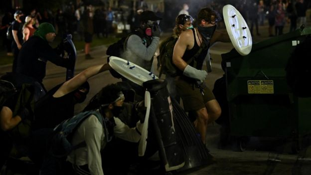 Protesters hold up make-shift shields during unrest in Kenosha