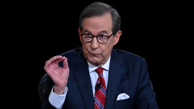 Debate moderator and Fox News anchor Chris Wallace directs the first 2020 presidential campaign