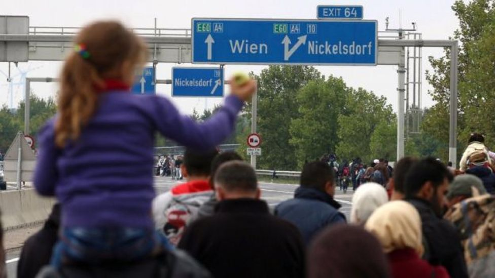 Migrants walk on the highway A4 toward Vienna near Nickelsdorf, Austria, on 11 September 2015