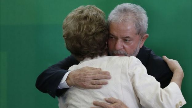 Brazil's former president, Luiz Inacio Lula da Silva hugs Brazil President Dilma Rousseff as he is sworn in as the new chief of staff in the Planalto Palace on March 17, 2016 in Brasilia, Brazil.