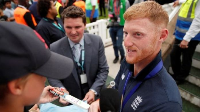 Ben Stokes signing autographs