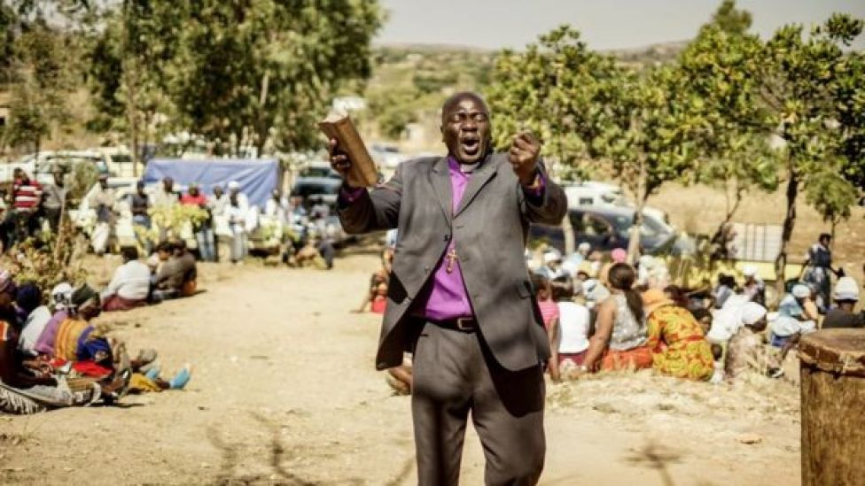 Bishop Guide Makore preaches during during the funeral ceremony of Ishmael Kumire, 42, shot during post-election violence on August 1 in Harare, at his homestead in Chinamhora village, Domboshava, outside Harare, on August 4, 2018.
