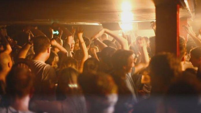 People dancing in a packed nightclub
