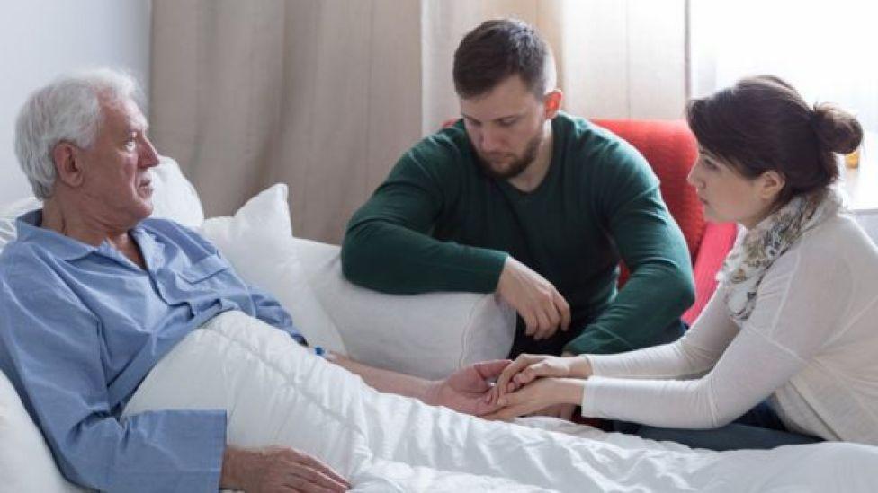 Paciente junto a su familia