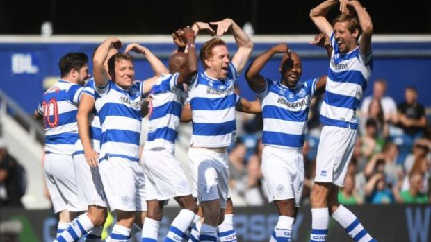 Players in the Game4Grenfell football match celebrate Sir Mo Farah's goal