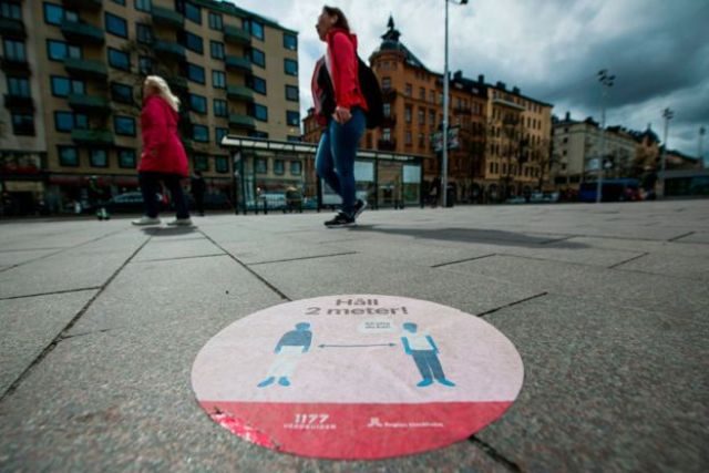 A big sticker of the healthcare services of Sweden on a pavement in Stockholm