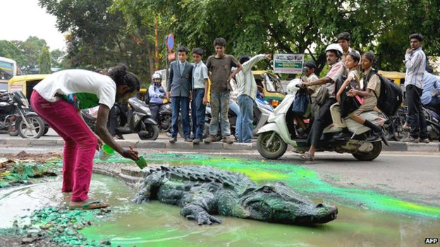 Indian artist creates crocodile pothole to get road fixed