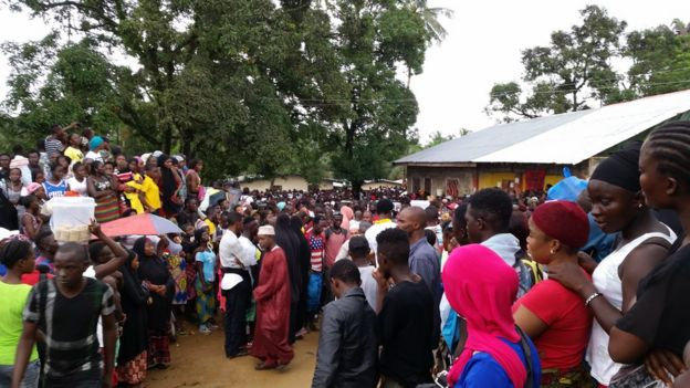 Crowds gather near the school