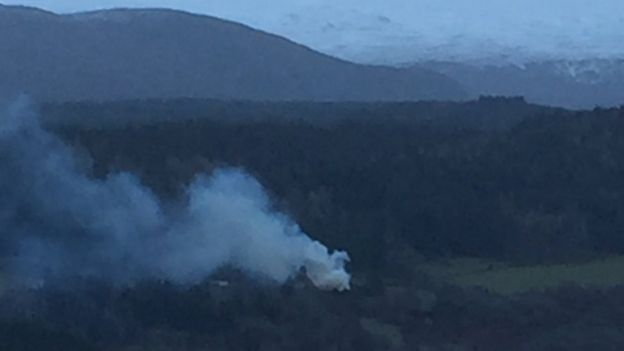 Smoke rising from the scene of the fire at Boleskine House