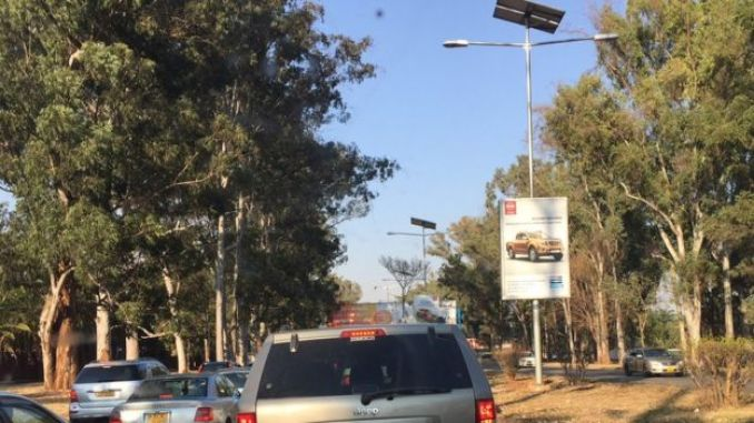 A street in Harare showing a solar-powered street lamp