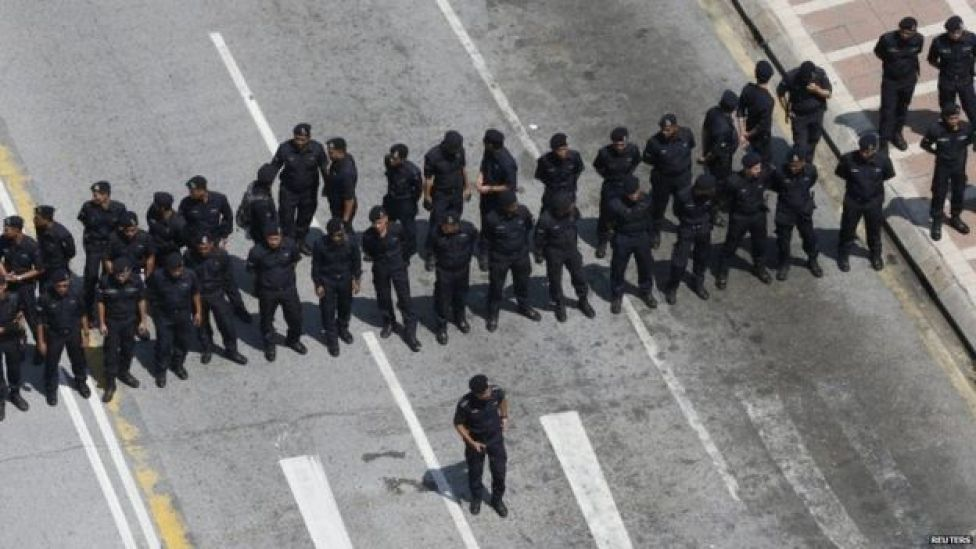 Police block a road ahead of a protest organised in Malaysia's capital city Kuala Lumpur