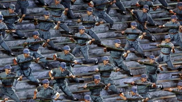 Actors dressed as Chinese soldiers