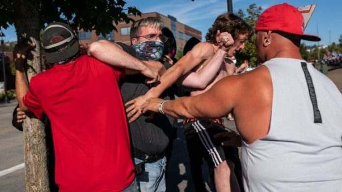 Fights broke out between anti-racism protestors and attendees of a pro-Trump rally on Saturday