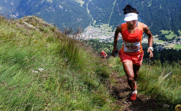 Mira Rai running up a mountain