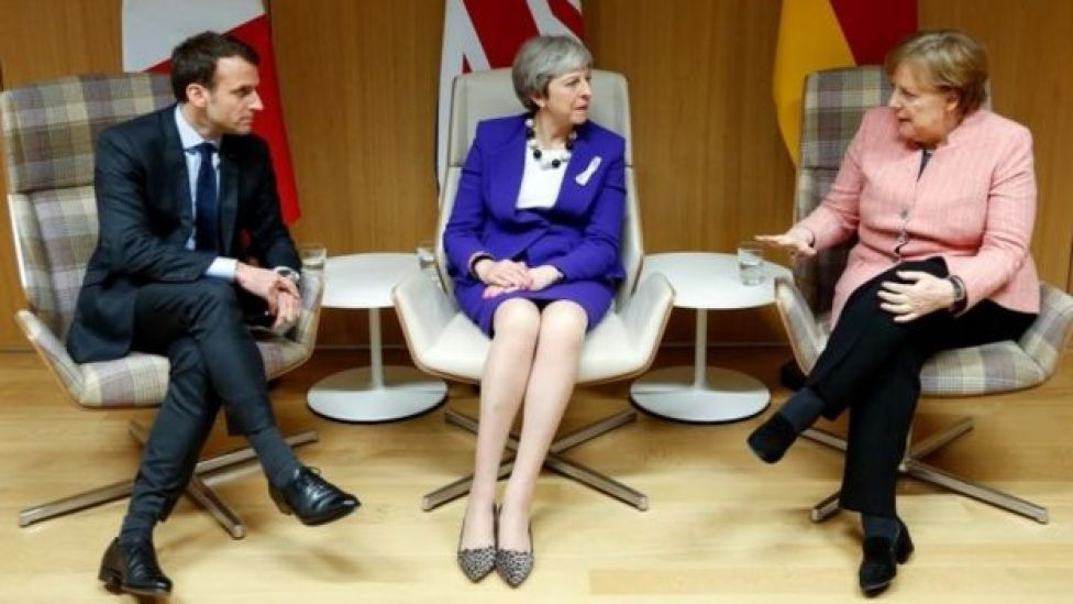 From left to right: French President Emmanuel Macron, UK Prime Minister Theresa May and German Chancellor Angela Merkel. File photo