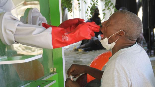 A patient who is suspected of suffering from COVID-19 coronavirus undergoes testing at the University of Maiduguri Teaching Hospital isolation centre on May 10, 2020