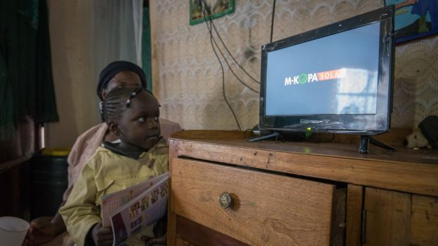 Young girls watching solar-powered TV