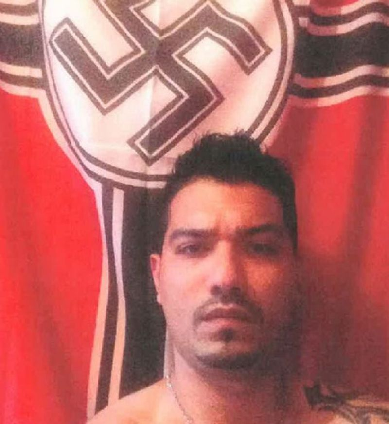 Ashkan Ebrahimi in front of Nazi flag