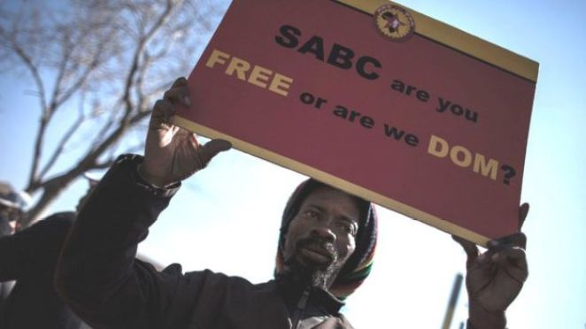 A protester at a rally outside the Johannesburg Constitutional Court in July 2016 in to protest against alleged bias and self-censorship in news coverage by the South African Broadcasting Corporation (SABC)